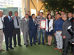 Anti-Recidivism Coalition founder Scott Budnick and LA County Supervisor Hilda Solis celebrate the graduation of 27 formerly incarcerated individuals from the LATTC Apprenticeship Program