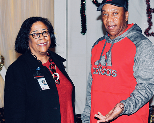 EWDD General Manager Jan Perry with YO! Watts YSC Director Hugh Carter at the December 21st open house
