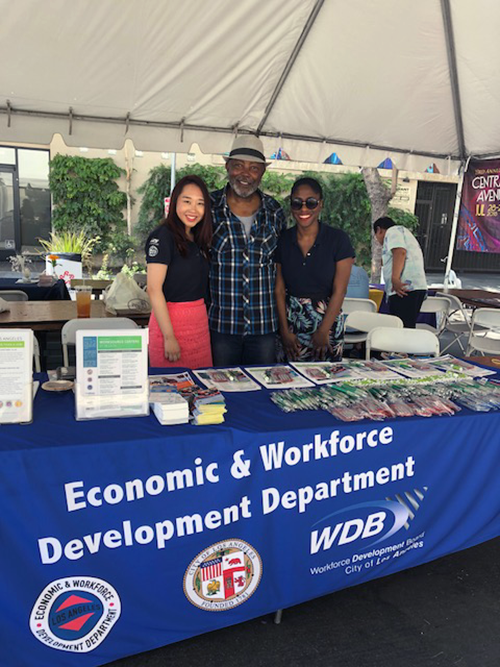 (left to right) EWDD staff Elis Lee, Michael Wynn and Firdaus Landou distributed info about EWDD services at the 23rd Annual Central Avenue Jazz Festival
