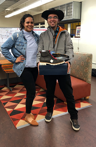 WorkSource helped LA:RISE participant Adam Guerra with his job hunt and gave him his work uniform for his new role as a supervisor with North East Trees