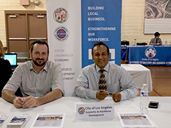 (left to right) EWDD's Alex Lakshtanov and Chris Rajapakse helping victims of the December fires with employment and business related support