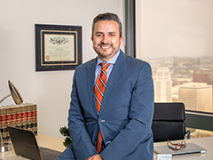 Martin Quiroz, Esquire, seated at his desk in his own downtown LA law firm, Quiroz Law (image courtesy of Martin Quiroz)