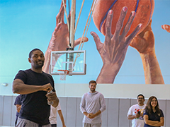 Former LA Laker Metta World Peace greets YouthSource participants while EWDD General Manager Jan Perry looks on with EWDD Youth Operations Team staff