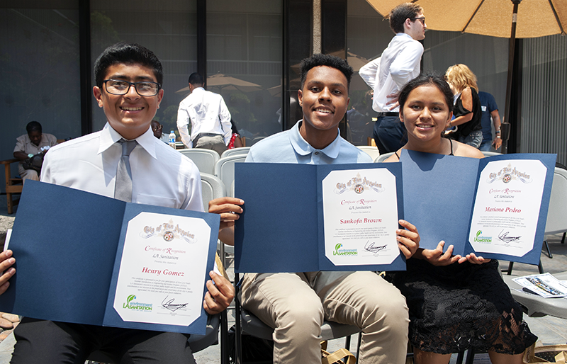 "Hire LA's Youth interns (left to right) Henry Gomez, Sankofa Brown and Mariana Pedro, display their completion certificates from the DPW Bureau of Sanitation's 2018 ""Summer Introduction to Engineering and Science"" program"