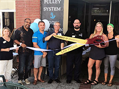 "Carla McDonough (second from right) at the grand opening of her dream business,  fitness studio ""Training for Balance"" in San Pedro, California"
