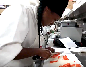 LAHTA Culinary Apprenticeship student practices her knife skills while julienning carrots