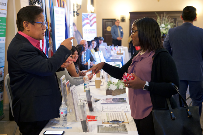 Business Development Loan Officer Terry Gubatan (left) of the South LA BusinessSource Center at the 2018 Entrepreneurship & Financial Literacy Conference for Veterans