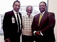 (left) EWDD BusinessSource Director Richard Pallay and EWDD Sr. Project Assistant Dennis Parks, with former Council District 8 Councilman Robert Farrell at a Ports O'Call community event