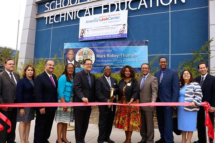 flanked by dignitaries from LA City, County and the LA Community College District, County Supervisor Mark Ridley-Thomas (center) cuts the ribbon at the grand opening of the South LA YouthSource Center at Los Angeles Southwest College