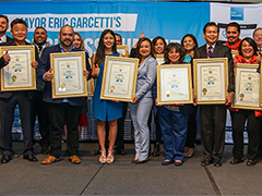 A row of LA entrepreneurs are honored at Mayor Eric Garcetti's 2018 Small Business Summit, where EWDD's Business Response Team held its first official event
