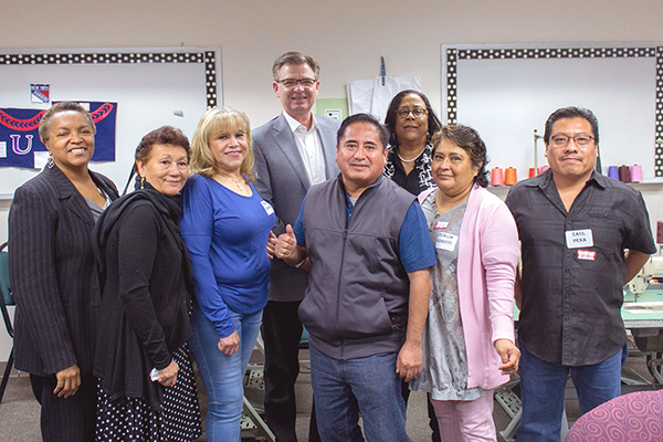 EWDD General Manager Jan Perry (back row, center) visited former American Apparel Workers at the Northeast Los Angeles WorkSource Center who are learning new skills to stay in the apparel industry (photo courtesy of @GoodwillSoCal)