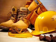 an image of construction employee apparel including work boots, a tool belt and a hard hat