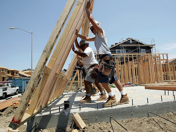image of construction workers framing a wall - The Jordan Downs Redevelopment Construction Job Fair, a hiring event specifically for local construction workers