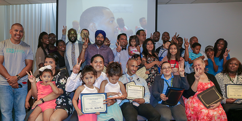Metro Bridge Bus Operator Training Academy graduates with family members flash peace signs on July 20, 2018. Metro Bus Operators typically flash peace signs as they pass each other on the road.