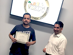 (left to right) Jose Molina, owner of MGD Door Installation, with South Los Angeles BusinessSource consultant Fernando Borja