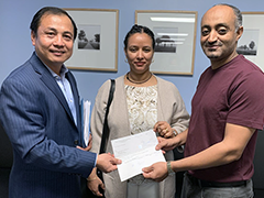 (left to right) Mid-City BusinessSource Center business counselor Steve Meng with long-term clients Helina Zerfu and Eyob Tadesse, owners of Buna Ethiopian Restaurant & Market