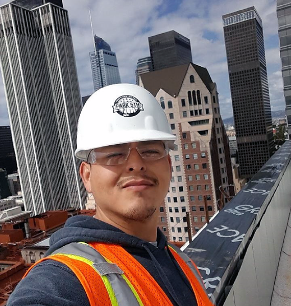 Compass Rose Collective (CRC) participant Raymond Saiz at his new job, obtained with the help of the CRC training