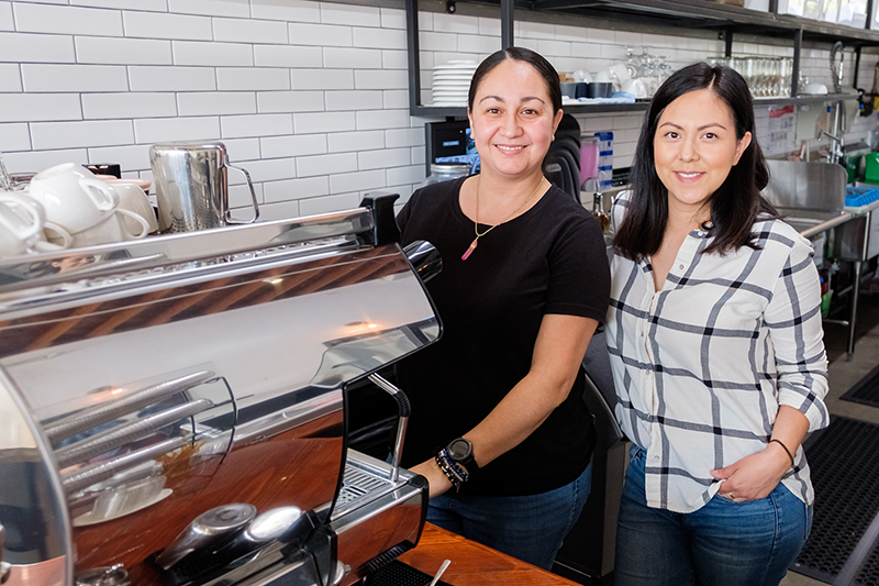 Los Angeles area entrepreneurs Kim Lopez (left) and Adriana Zuniga (right) at their newly opened coffee shop, Cara Vana, in North Hollywood