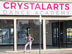 Crystal Duran displays the storefront of her dance academy, CrystalArts