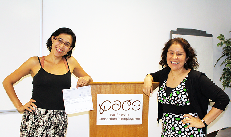 (left to right) Crystal Duran and Veronica Lopez, her PACE business counselor, pose for a photo as she receives a $5,000 mini micro loan check for her dance academy, CrystalArts