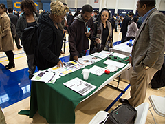Job seekers stop at the Southeast Los Angeles WorkSource Center booth run by EWDD partner Watts Labor Community Action Committee at the Fourth Homeless Services Job Fair on Thursday January 17, 2019