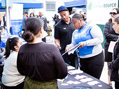Job seekers get employment and job training information from the Homeboy Industries booth at the Hollywood WSC Second Chance Career and Resource Fair