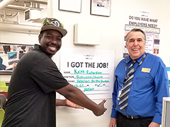 Keith Richardson thanks Career Coach John Wilson for helping him land a job at Delicious at the Dunbar