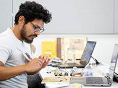 One of the LACI Advanced Prototyping Center Fellowship Program participants learns technical details of advanced circuitry