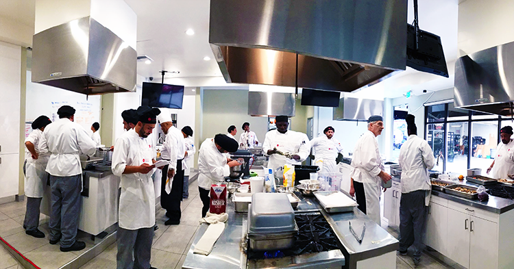 LAHTA Culinary Apprenticeship students preparing food for the Koreatown Culinary Training Facility grand opening ceremony