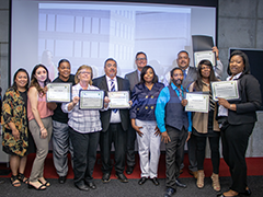 Seven graduates of the June 2019 LA Valley College Metro Training Academy program pose with their certification awards