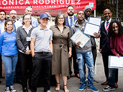 Los Angeles City Councilwoman Monica Rodriguez (center) hosted a culmination ceremony honoring the 2017 Wildfires National Dislocated Worker Grant (NDWG) clean-up crews; EWDD Interim General Manager John L. Reamer (far right) gave the keynote speech