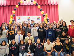 the 71 Para Los Niños high school graduates from the Central and East YouthSource Centers at their graduation ceremony in June 2019