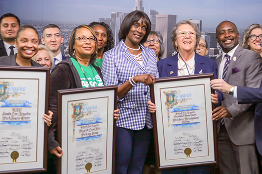 Pamela Stokes (center) went through the South Los Angeles WorkSource Center to join the Targeted Local Hire Program and now works as an Administrative Clerk for LAWA