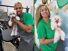 Showing off two freshly groomed dogs at their Lakeview Terrace pet grooming business, Wash My Dog - Terryl Daluz (left) holds a Bichon Frise puppy, and Andrea Carter (right) holds an adult Pomeranian