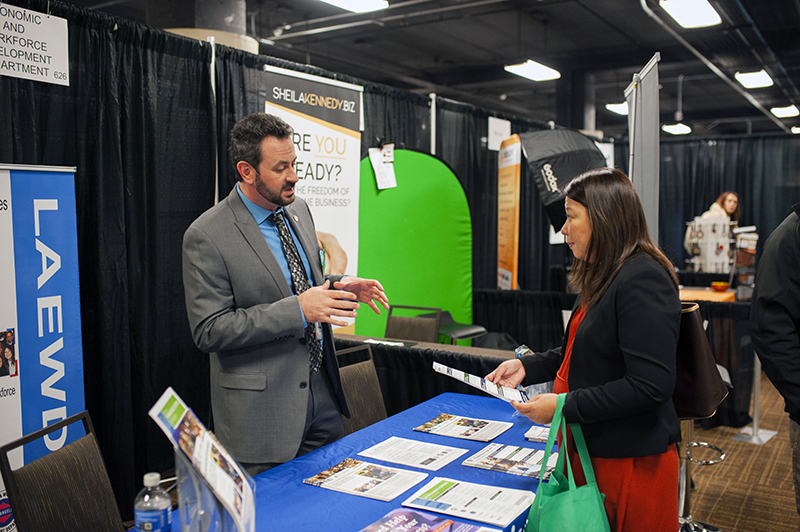 EWDD Industrial Commercial Finance Officer Alex Lakshtanov (left) shares information about the City's Financing Programs at the Small Business Expo on Wednesday October 30, 2019