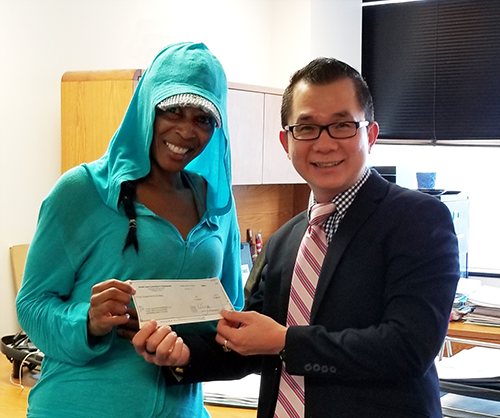 Glow Girl Enterprises owner Enjunaya Canton (left) with Mid City BusinessSource loan counselor Phong Le