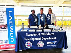 EWDD information Booth at the August Dodger Stadium LA Community Job Fair, staffed with representatives from WorkSource Centers