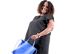 Lavena models one of her handcrafted leather handbags (photo credit: Anita Hodges for asiseditorial.com)