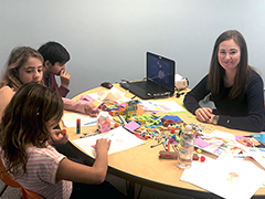 Ekaterina Evdokimova (far right) teaching the nuances of the Russian language to three young students by using art at her new Encino business 2Belingual Language School