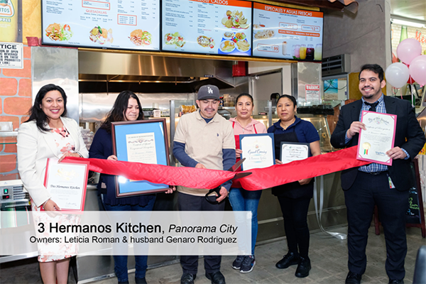 Leticia Roman and Genaro Rodriguez, owners of Panorama City restaurant 3 Hermanos Kitchen, cut the ribbon at their grand opening