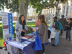 EWDD Business Response Team member Yovana Perez (left) at an EWDD booth assisting small business owners at the LA Women's Entrepreneurship Day event on November 19, 2019