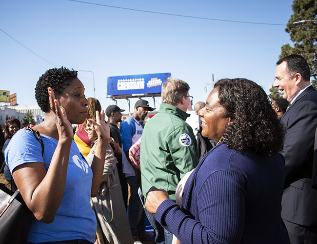 EWDD General Manager Carolyn Hull (right) chats with LADOT Assistant General Manager Monique Earl at the Destination Crenshaw groundbreaking ceremony February 29, 2020.
