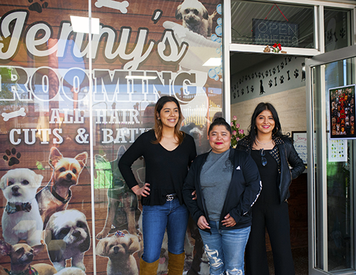 "(left to right) Jenny Zamora with her mother and sister Chris Zamora at the grand opening of Jenny's business ""Jenny's Dog Grooming"" in Panorama City on January 31, 2020"