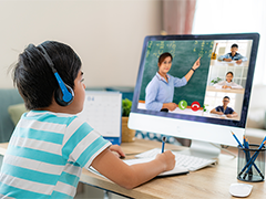 elementary age child on a computer attending a virtual class