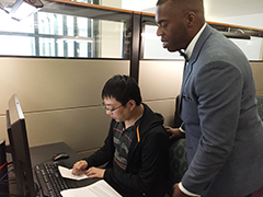 Christopher Chao assisted by Johnathan Davis, Workforce Development Specialist for the Central Library Portal