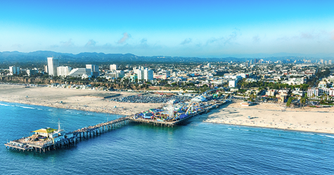 Aerial panoramic view of the Santa Monica Pier looking towards downtown Los Angeles
