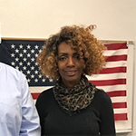 Veteran Caryette Williams-Muhammed (right) receive barista training at the LA Hospitality Training Academy, leading to a full time job, with the help of WorkSource Center Career Coach Ernesto Garcia (left)