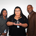 (from left to right) EWDD Youth Operations Director Makeda Vela, EWDD CASW Destiny Nguyen and EWDD Interim General Manager John L Reamer, Jr, stand with the #SummerJobsConnect Social Media Award