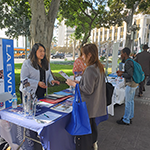 EWDD Business Response Team member Yovana Perez (left) works with a client at the LA Women's Entrepreneurship Day event on November 19, 2019