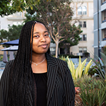 LA city's Targeted Local Hire Program alum Breeana London, pictured outside the EWDD offices, earned civil service status and received a promotion within a 20 month period